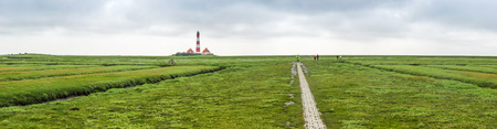 westerheversand: Beautiful landscape with famous Westerheversand lighthouse at North Sea in Nordfriesland, Schleswig-Holstein, Germany