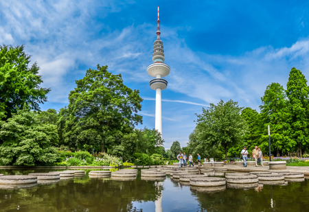 hertz: Beautiful view of flower garden in Planten um Blomen park with famous Heinrich-Hertz-Turm radio telecommunication tower in the background, Hamburg, Germany Stock Photo