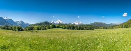 spring landscape: Beautiful mountain landscape in the Bavarian Alps with village of Berchtesgaden and Watzmann massif in the background at sunrise, Nationalpark Berchtesgadener Land, Bavaria, Germany