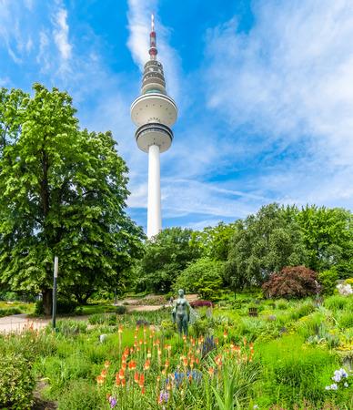 hertz: Beautiful view of flower garden in Planten um Blomen park with famous Heinrich-Hertz-Turm radio telecommunication tower in the background, Hamburg, Germany Stock Photo