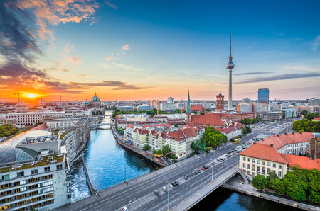 and germany: Aerial view of Berlin skyline with famous TV tower and Spree river in beautiful evening light at sunset, Germany