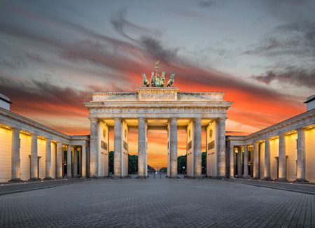 Panoramic view of famous Brandenburg Gate Brandenburg Gate, one of the best-known landmarks and national symbols of Germany, in beautiful golden evening light at sunset, Pariser Platz, Berlin, Germany