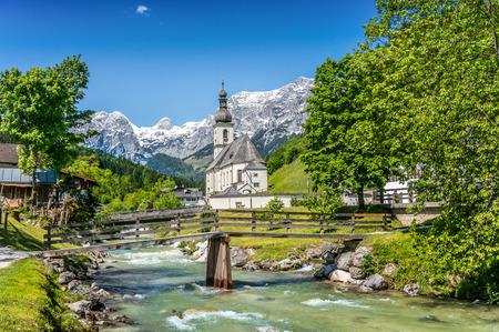 Scenic mountain landscape in the Bavarian Alps with famous Parish Church of St. Sebastian in the village of Ramsau, Nationalpark Berchtesgadener Land, Upper Bavaria, Germany 版權商用圖片