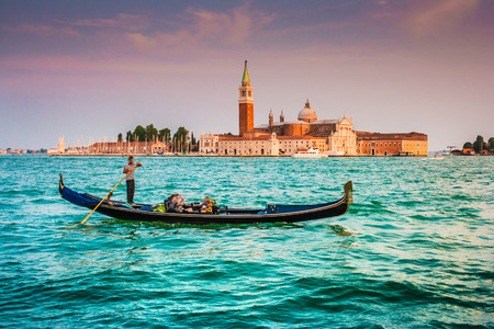 canals: Beautiful view of traditional Gondola on Canal Grande with San Giorgio Maggiore church in the background at sunset, San Marco, Venice, Italy