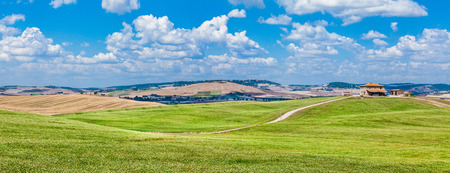 on the hill: Scenic Tuscany landscape with rolling hills and traditional farm house in Val dOrcia, Italy