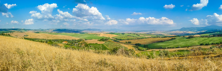 san quirico d'orcia: Scenic Tuscany landscape with rolling hills and valleys in golden evening light, Val dOrcia, Italy