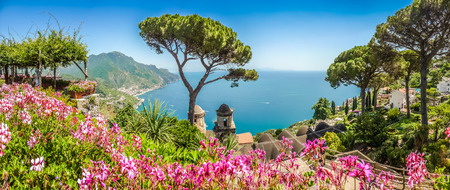 panorama: Scenic picture-postcard view of famous Amalfi Coast with Gulf of Salerno from Villa Rufolo gardens in Ravello, Campania, Italy Stock Photo
