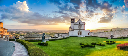 Famous Basilica of St. Francis of Assisi Basilica Papale di San Francesco at sunset in Assisi, Umbria, Italy Stock Photo
