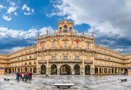 Famous and historic  Plaza Mayor in Salamanca on a sunny day with dramatic clouds, Castilla y Leon, Spain Stock Photo