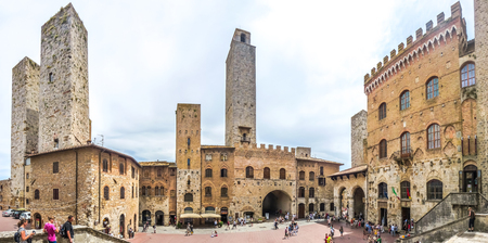 Panoramic view of famous Piazza del Duomo in the historic town of  San Gimignano on a sunny day, Tuscany, Italy Stock Photo