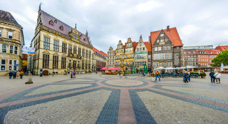 Ancient Bremen Market Square in the centre of the Hanseatic City of Bremen with view on The Schuetting former guild house and famous Raths-Buildings, Germany
