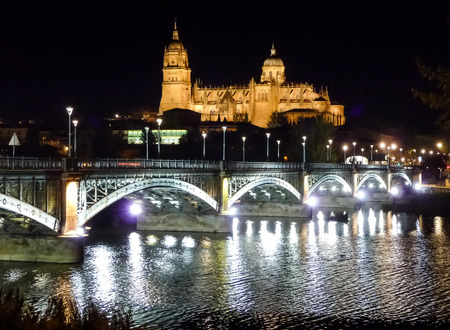 spain: Beautiful view of the historic city of Salamanca with New Cathedral and Enrique Esteban bridge at night, Castilla y Leon region, Spain Stock Photo