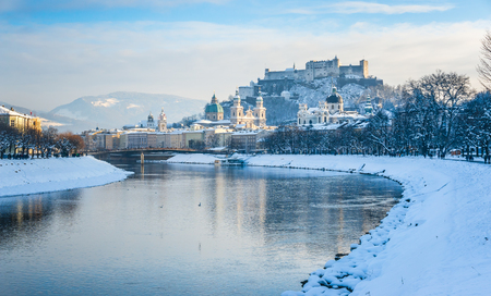 and in winter: Beautiful panoramic view of Salzburg skyline with Festung Hohensalzburg and river Salzach in winter, Salzburger Land, Austria Stock Photo