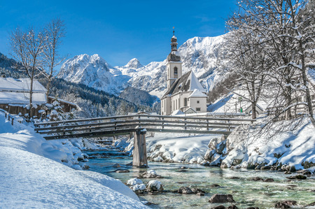 Panoramic view of scenic winter landscape in the Bavarian Alps with famous Parish Church of St. Sebastian in the village of Ramsau, Nationalpark Berchtesgadener Land, Upper Bavaria, Germany