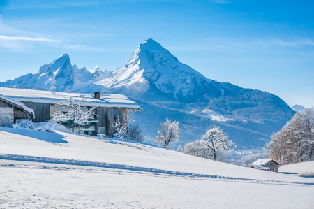 farm background: Beautiful mountain landscape in the Bavarian Alps with traditional farm house and  famous Watzmann in the background, Nationalpark Berchtesgadener Land, Bavaria, Germany Stock Photo