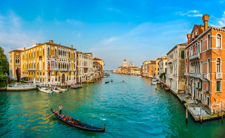 canals: Panoramic view of famous Canal Grande and Basilica di Santa Maria della Salute at sunset in Venice, Italy