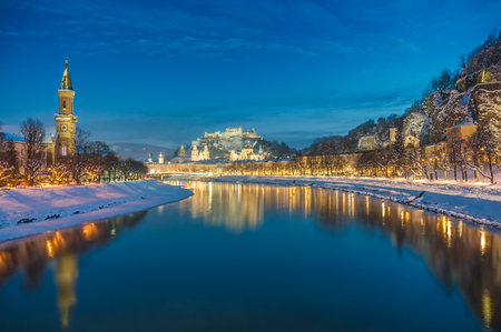 amadeus: Beautiful view of the historic city of Salzburg with Salzach river in winter during blue hour, Salzburger Land, Austria Stock Photo