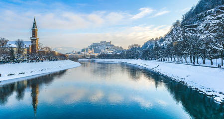 salzach: Beautiful panoramic view of Salzburg skyline with Festung Hohensalzburg and river Salzach in winter, Salzburger Land, Austria Stock Photo