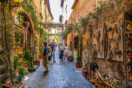 Beautiful view of frisky alley with ancient buildings at square near the Cathedral of Orvieto Duomo di Orvieto, Umbria, Italy