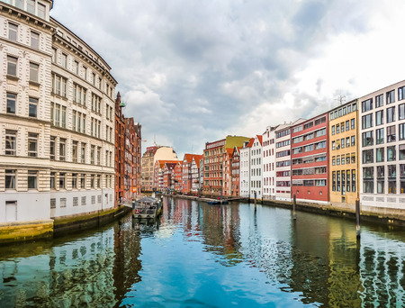 altstadt: Beautiful view of colorful buildings and Nikolaifleet from famous Holzbrucke so-called wooden bridge in the Altstadt quarter of Hamburg, Germany