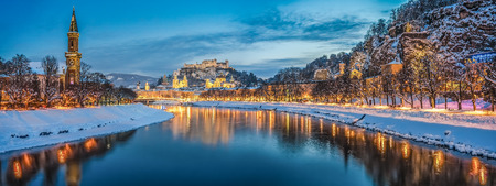 city night: Beautiful view of the historic city of Salzburg with Salzach river in winter during blue hour, Salzburger Land, Austria Stock Photo