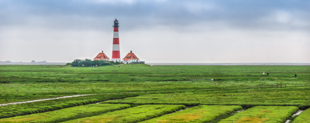 westerheversand lighthouse: Beautiful landscape with famous Westerheversand lighthouse at North Sea in Nordfriesland, Schleswig-Holstein, Germany