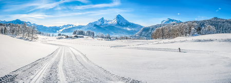 landscape background: Panoramic view of beautiful winter wonderland landscape in the Bavarian Alps with cross-country slopes and famous Watzmann massif in the background, Nationalpark Berchtesgadener Land, Bavaria, Germany