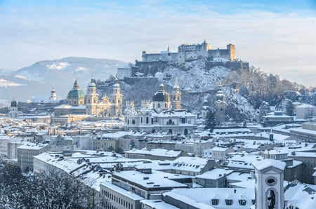 city landscape: Beautiful panoramic view of Salzburg skyline with Festung Hohensalzburg and cathedrals in winter, Salzburger Land, Austria