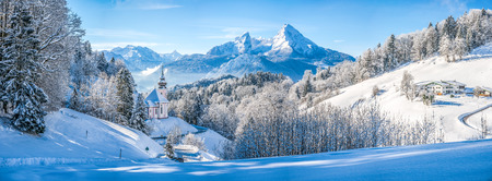 christmas winter: Panoramic view of beautiful winter landscape in the Bavarian Alps with pilgrimage church of Maria Gern and famous Watzmann massif in the background, Nationalpark Berchtesgadener Land, Bavaria, Germany