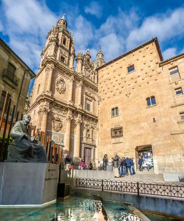 plateresque: Famous Casa de las Conchas with La Clerecia Church in Salamanca, Castilla y Leon, Spain