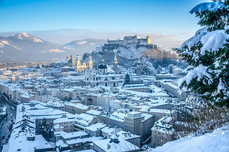 Beautiful panoramic view of Salzburg skyline with Festung Hohensalzburg and cathedrals in winter, Salzburger Land, Austria