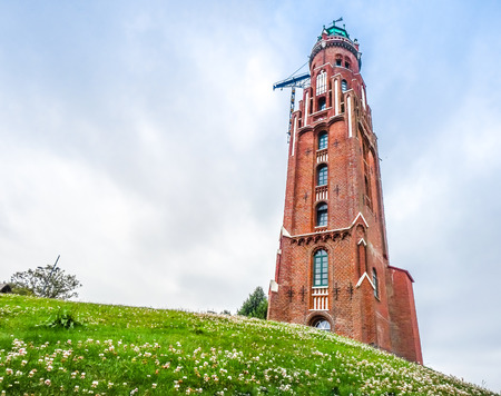 Beautiful view of old Loschen-lighthouse Simon Loschen tower in famous Havenwelten in the hanseatic city of Bremerhaven, Bremen, Germany