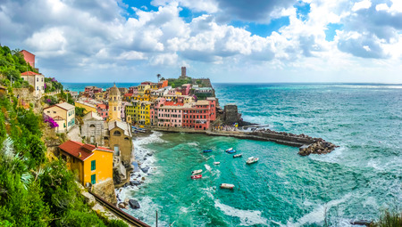 vernazza: Beautiful view of Vernazza, one of the five famous fisherman villages of Cinque Terre with dramatic cloudscape in Liguria, Italy Stock Photo