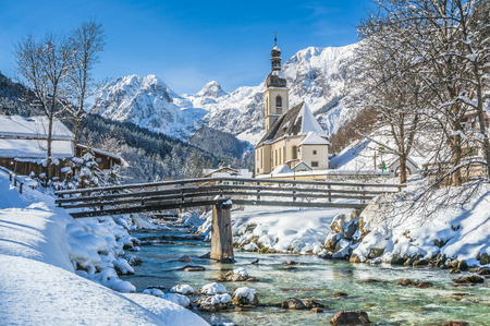 church: Panoramic view of scenic winter landscape in the Bavarian Alps with famous Parish Church of St. Sebastian in the village of Ramsau, Nationalpark Berchtesgadener Land, Upper Bavaria, Germany
