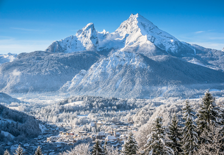 austrian village: Beautiful mountain landscape in the Bavarian Alps with village of Berchtesgaden and Watzmann massif in the background at sunrise, Nationalpark Berchtesgadener Land, Bavaria, Germany