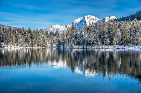 Panoramic view of scenic idyllic winter landscape in the Bavarian Alps at famous mountain lake Hintersee, Ramsau, Nationalpark Berchtesgadener Land, Upper Bavaria, Germany Stock Photo