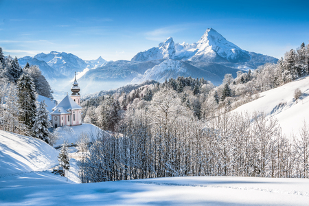 salzburg: Panoramic view of beautiful winter landscape in the Bavarian Alps with pilgrimage church of Maria Gern and famous Watzmann massif in the background, Nationalpark Berchtesgadener Land, Bavaria, Germany