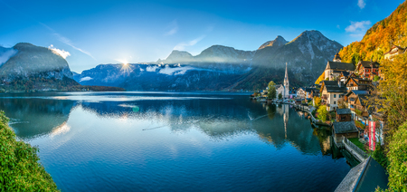 panoramic view: Scenic panoramic picture-postcard view of famous Hallstatt mountain village with Hallstatter See in the Austrian Alps in beautiful golden morning light in fall, Salzkammergut, Austria