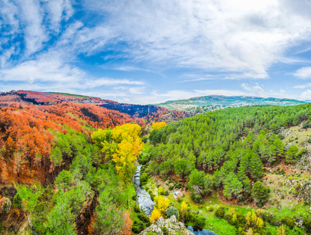leon: Beautiful autumn landscape with colorful forests and blue sky near Madrid in the autonomous community of Castilla y Leon, Spain Stock Photo