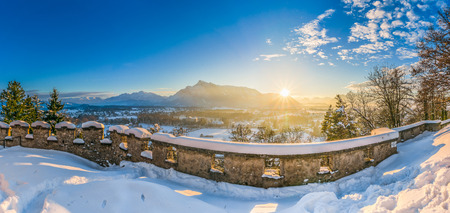 sunset city: Beautiful view of the historic city of Salzburg and mountain landscape in in idyllic winter sunset setting, Salzburger Land, Austria