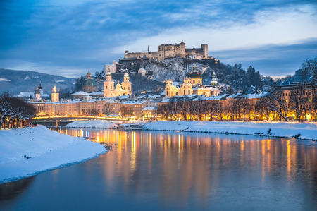 salzach: Beautiful view of the historic city of Salzburg with Salzach river in winter during blue hour, Salzburger Land, Austria Stock Photo