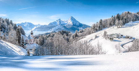 countryside landscape: Panoramic view of beautiful winter landscape in the Bavarian Alps with pilgrimage church of Maria Gern and famous Watzmann massif in the background, Nationalpark Berchtesgadener Land, Bavaria, Germany