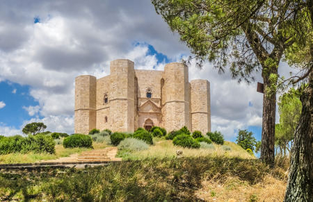 holy: Beautiful view of Castel del Monte, the famous castle built in an octagonal shape by the Holy Roman Emperor Frederick II in the 13th century in Apulia, southeast Italy