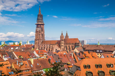 sunny: Historic town of Freiburg im Breisgau with famous Freiburg Minster cathedral in beautiful morning light, state of Baden-Wurttemberg, southwest Germany Stock Photo