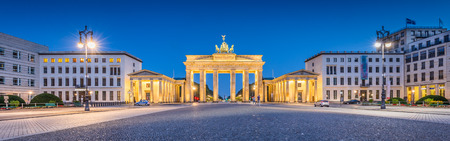 panorama: Panoramic view of Pariser Platz with famous Brandenburg Gate, one of the best-known landmarks and national symbols of Germany, in twilight during blue hour at dawn, Berlin, Germany Stock Photo