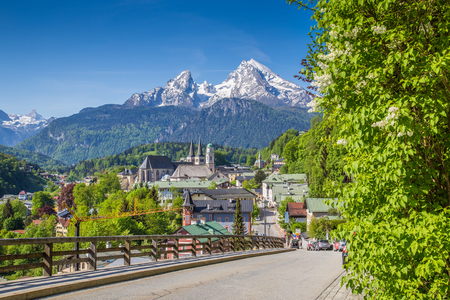 street view: Historic town of Berchtesgaden with famous Watzmann mountain in the background on a sunny day in springtime, Nationalpark Berchtesgadener Land, Upper Bavaria, Germany