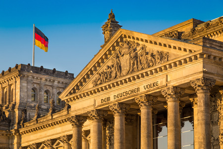 government: Close-up view of famous Reichstag building, seat of the German Parliament Deutscher Bundestag, in beautiful golden evening light at sunset, Berlin, Germany