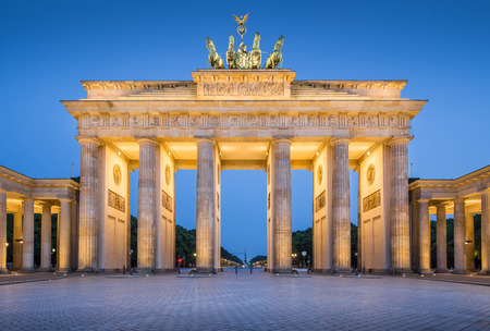 morning blue hour: Panoramic view of famous Brandenburger Tor, one of the best-known landmarks and national symbols of Germany, in twilight during blue hour at dawn, Berlin, Germany