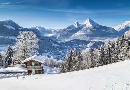 Beautiful mountain landscape in the Bavarian Alps with village of Berchtesgaden and Watzmann massif in the background at sunrise, Nationalpark Berchtesgadener Land, Bavaria, Germany Reklamní fotografie - 49066437