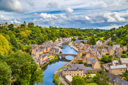 Aerial view of the historic town of Dinan with Rance river with dramatic cloudscape, Cotes-d'Armor department, Bretagne, northwestern France Standard-Bild